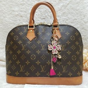 80df0be03252 Women s Louis Vuitton Alma Handbags